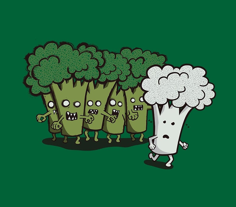 Cartoon depicting zombie broccoli chasing a cauliflower floret - cauliflower and potato curry