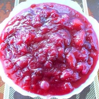 Overhead view of a white bowl with vegan cranberry sauce