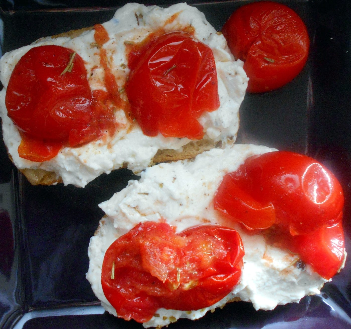 Overhead view of 2 slices of a bread with ricotta cheese and camapari tomatoes - grilled cheese sandwich