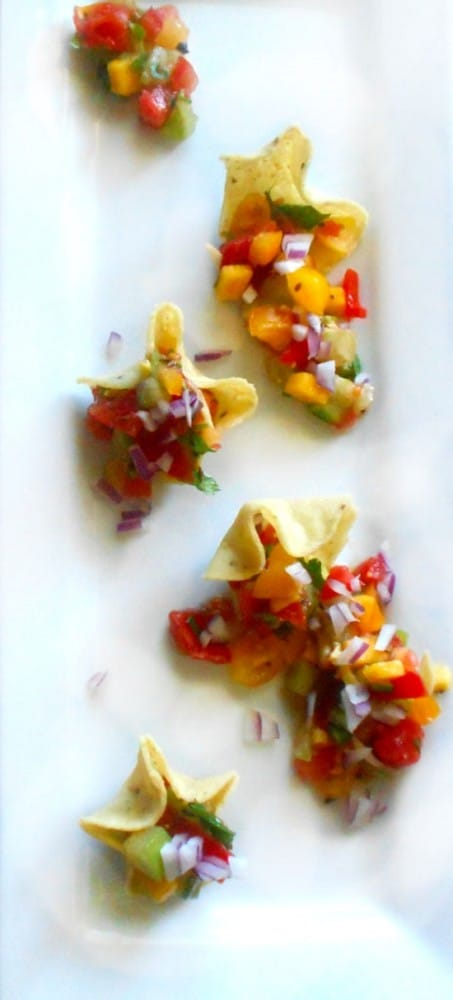 5 Tomato Salsa made with a variety of tomatoes. Game-day salsa and works grea with any chips