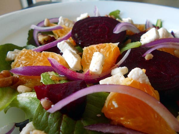 Closeup view of a salad plate filled with oranges and greens - Beet Salad with Oranges