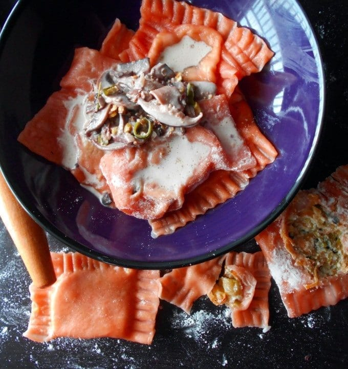 Tomato Ravioli made with Squash filling and served with a creamy mushroom sauce. Quick and simple vegetarian pasta recipe. Perfect dinner meal especially on Valentine's Day