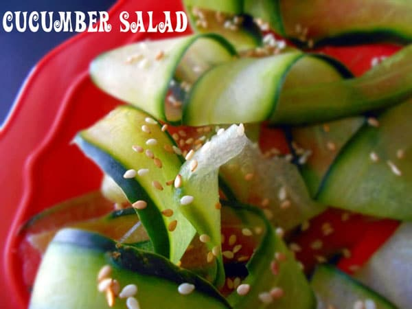 Closeup of strips of cucumber with sesame - Cucumber Salad