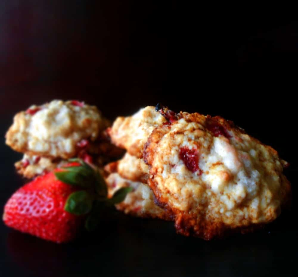 Front view of strawberry shortcake cookies with a strawberry on the side