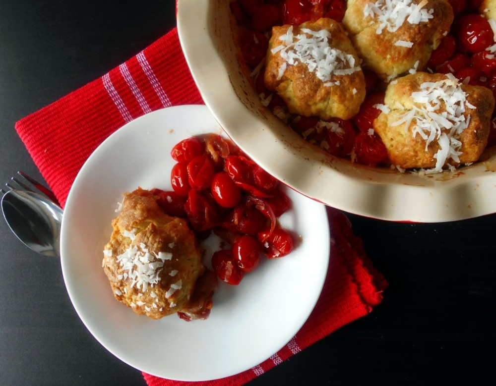 Top view of tomato cobbler on a white plate and tomato cobbler in a pie dish on the side