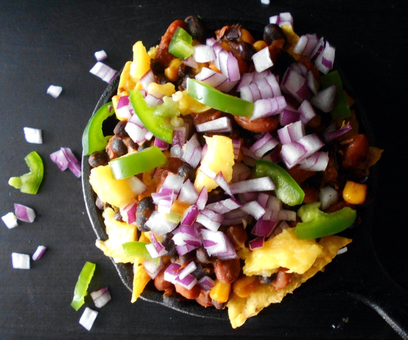 Vegetarian Nachos - Oooey-gooey, cheesy goodness. made with beans, cheese and mangos. Comfort food