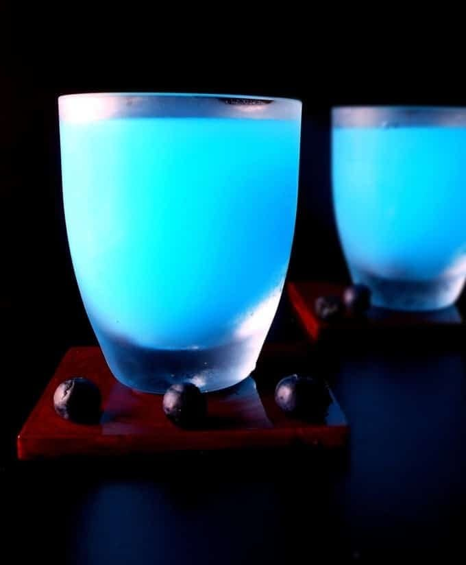Blue Lemonade - perfect summer lemonade recipe with a bit of color added to make it appealing. Use fresh blueberries in the ice cubes.