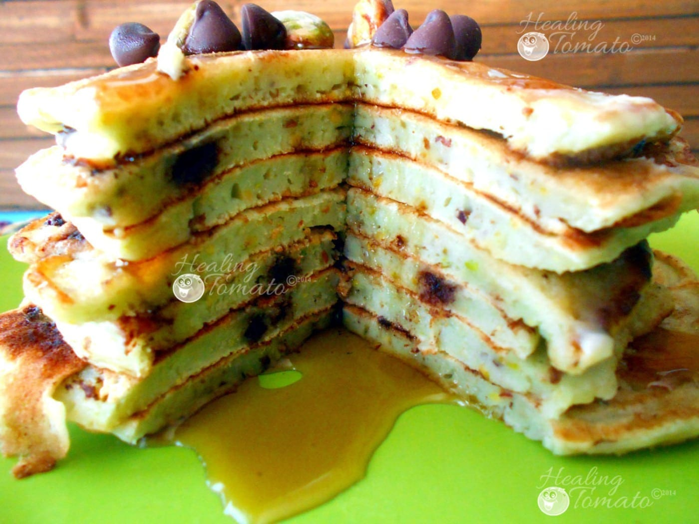 Closeup view of a section of a stack of vegan chocolate chip pancakes