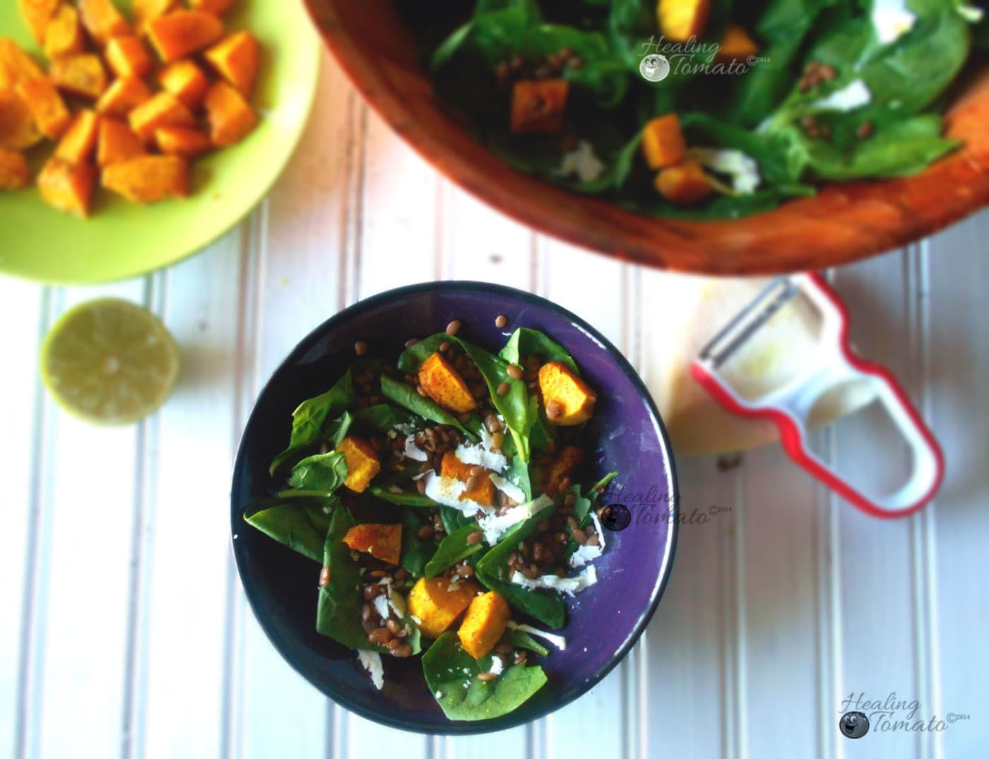 Overhead view of spinach lentil salad withspiced pumpkins