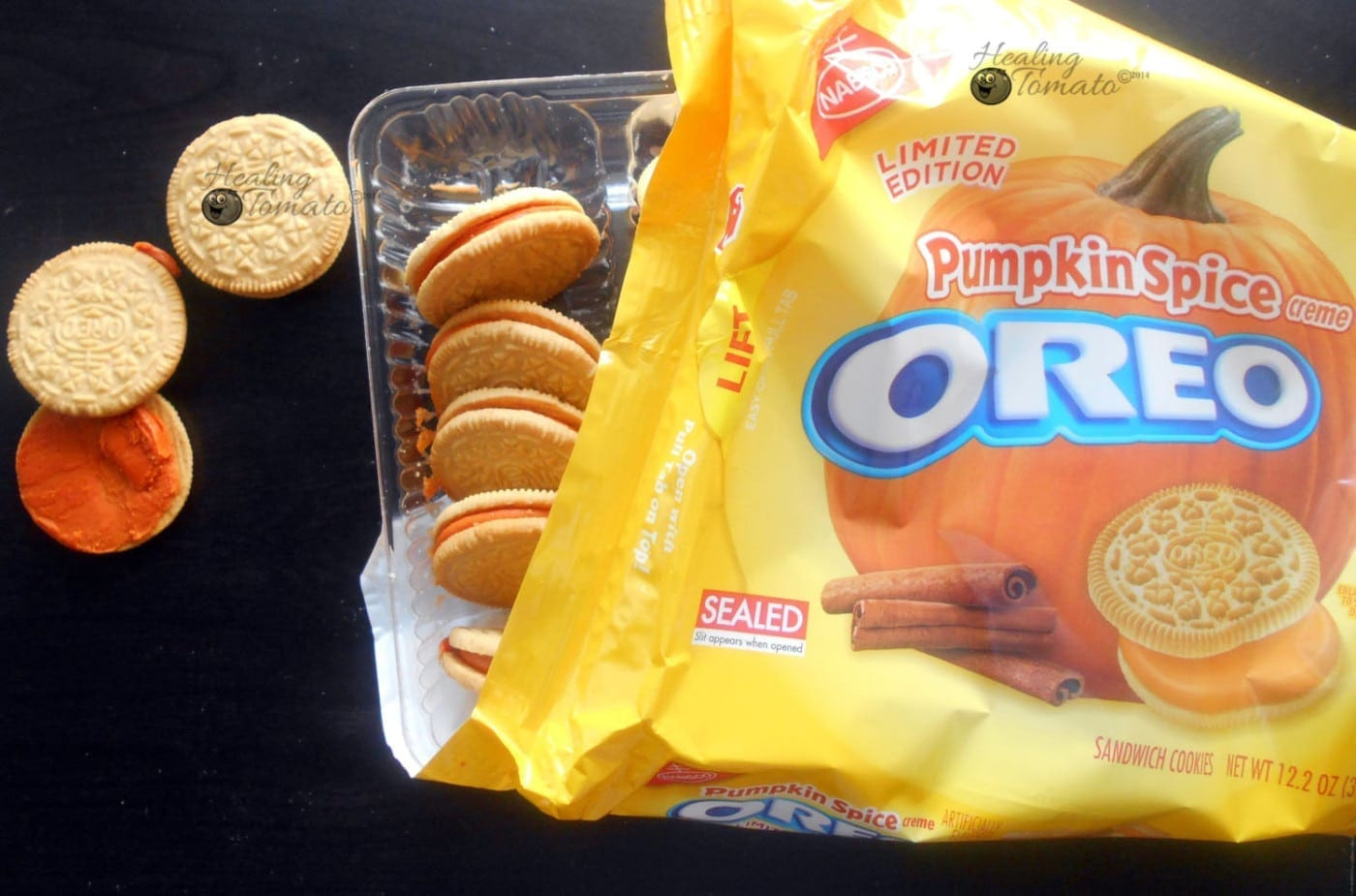 Pumpkin Spice oreos in pacakage with a couple oreos outside and opened