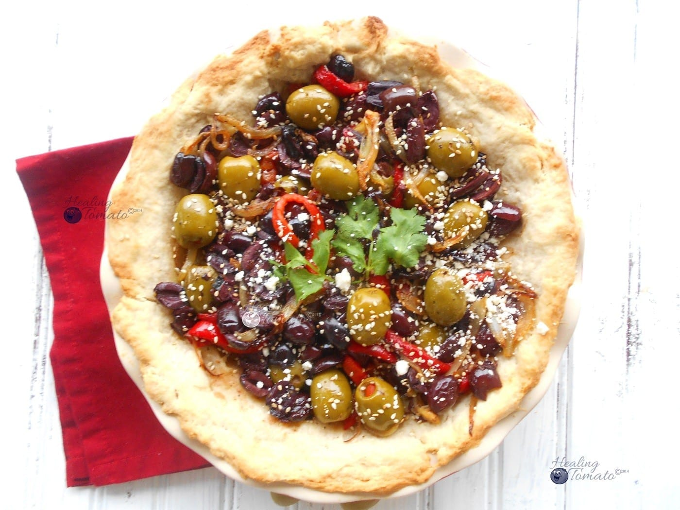 Overhead view of Mezzetta Recipe for Olive Pie on red napkin