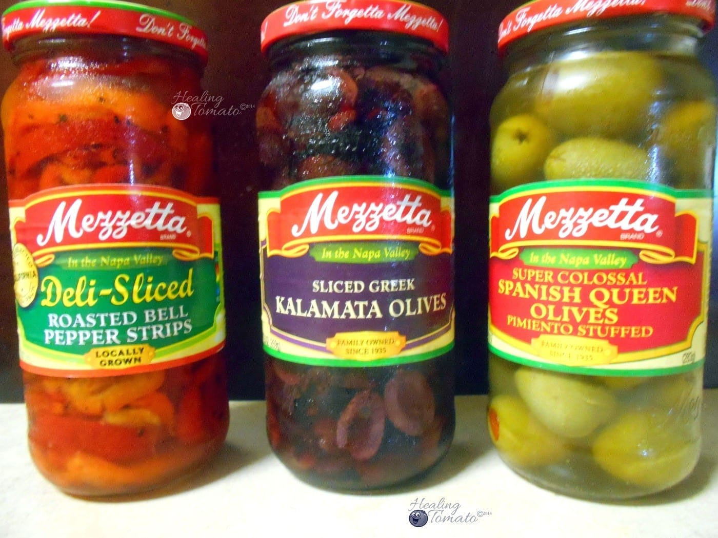 Front view of 3 mezzetta products in a glass jar