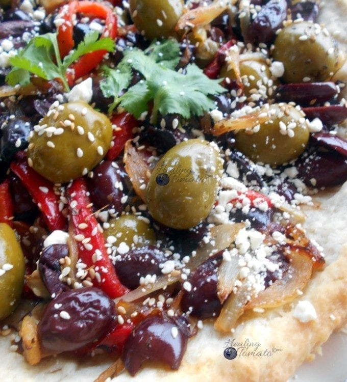 An olives recipe like no other. This savory pie recipe is perfect the holiday season and year round. Made with 2 types of olives, caramelized onions and sweet peppers, it is the perfect comfort food pie.