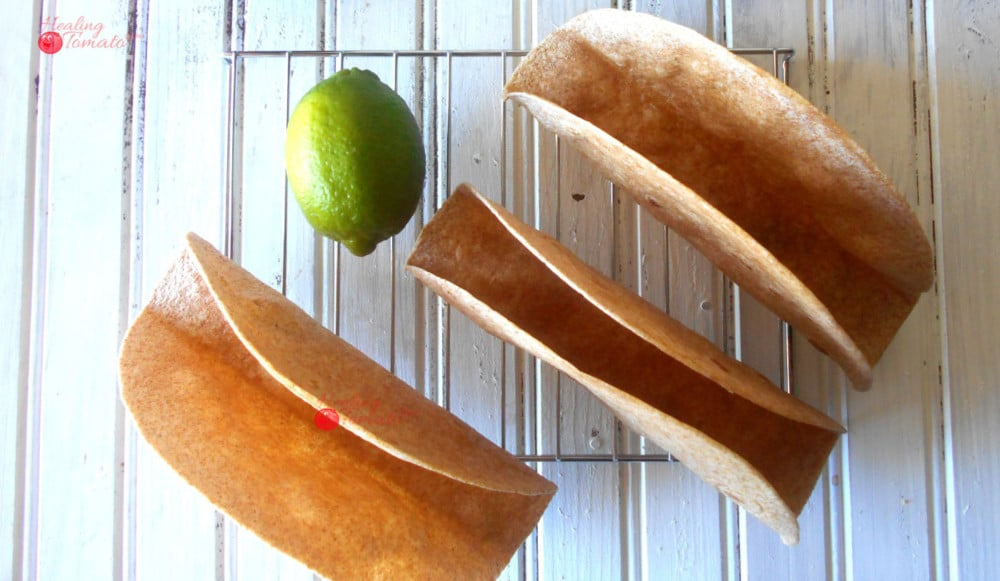 Overhead View of 3 Homemade Taco Shells Grande on a Cooling Rack with 1 Lime in the Middle