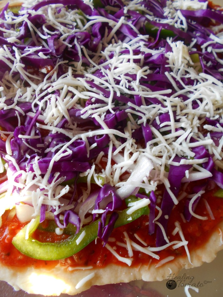 Front view of red cabbage pizza pie before going into the oven