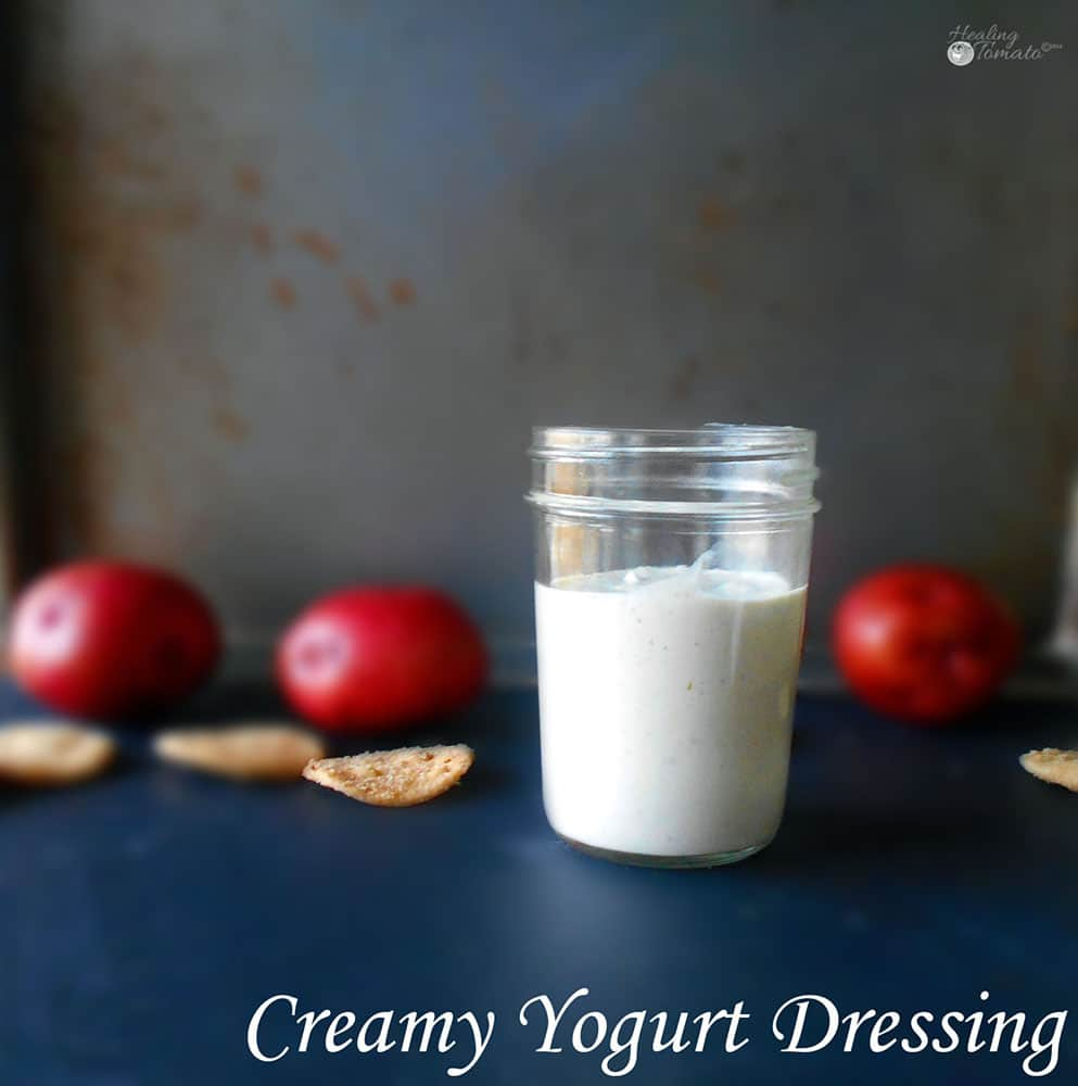 Front view of a mason jar filled with creamy yogurt dressing