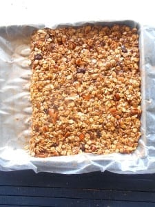 Homemade Granola bars in a block on a baking tray