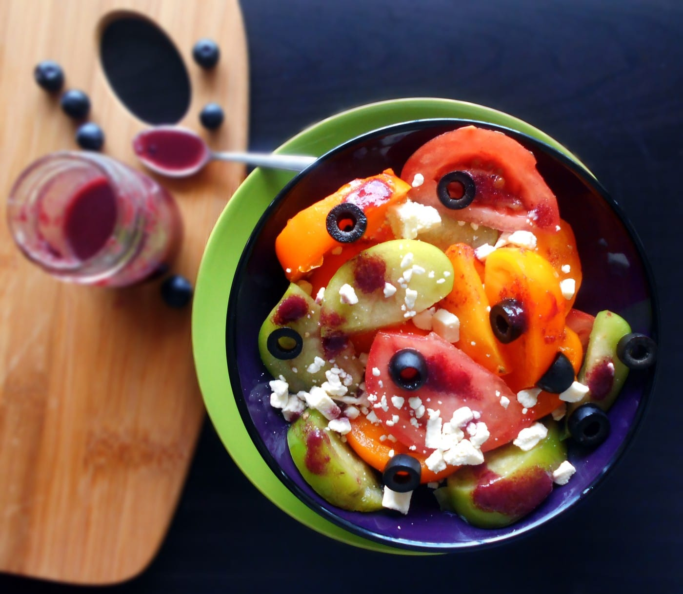 Mediterranean Tomato Salad - Usea variety of tomatoes, add olives, feta cheese and top it with a blueberry vinaigrette. Comes together in a few minutes. Quick and simple side salad