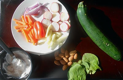 Overhead view of all the ingredients needed to make zucchini rolls