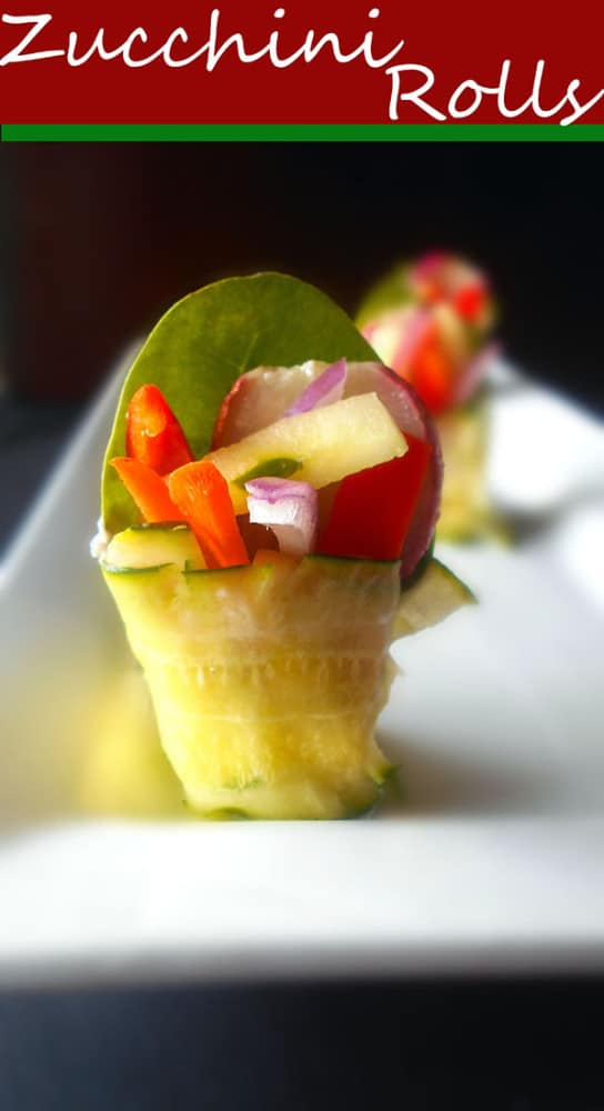 Zucchini Rolls with carrots, spinach, buttered radish, yogurt, almonds, red onions, mini sweet peppers and cucumber