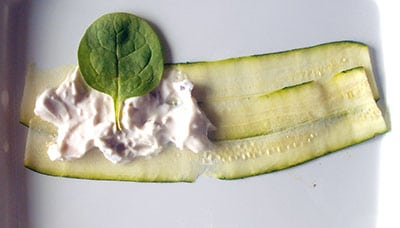 spinach leaf on top of the yogurt for the zucchini rolls