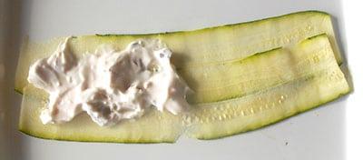 Yogurt spread on part of the zucchini rolls