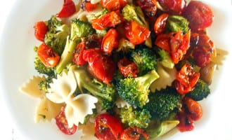 Roasted Broccoli pasta with Freshly Roasted Red Tomatoes. Topped with lemon juice