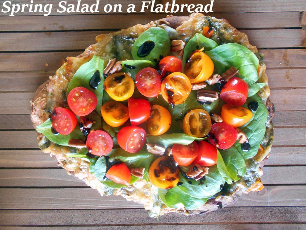 Spring Salad On A Flatbread - Made with baby spinach, cherry tomatoes and pecans. Drizzled with Balasmic Reduction Sauce. Flatbread made with Pesto, mini sweet peppers and cheese https://www.healingtomato.com/2015/04/08/spring-salad-on-flatbread-pizza
