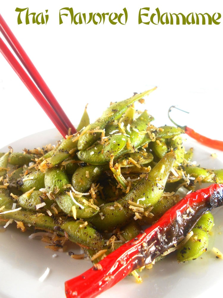 Coconut spiced edamame with coconut and a pair of red chopstickes poking out of it