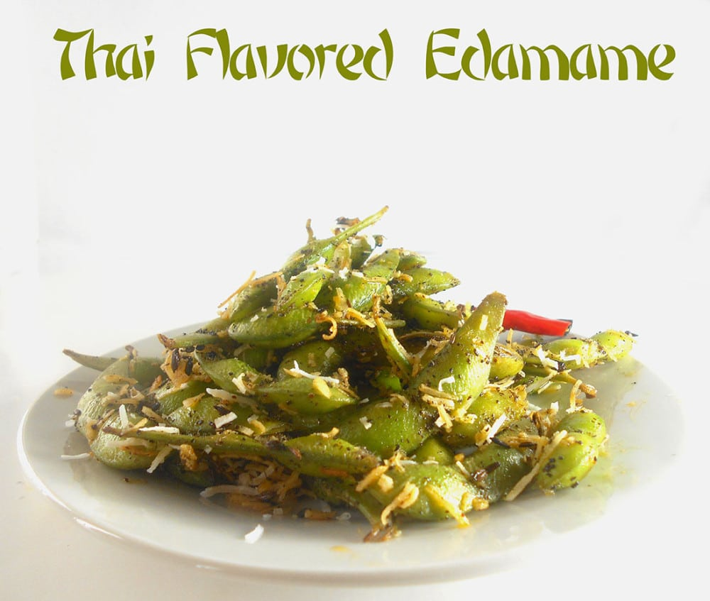 Front view of aa white plate filled with Thai Flavored Edamame and garnished with ccoonut shavings