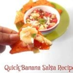 Front view of the Author Holding a Tortilla Chip Loaded with the Banana Salsa