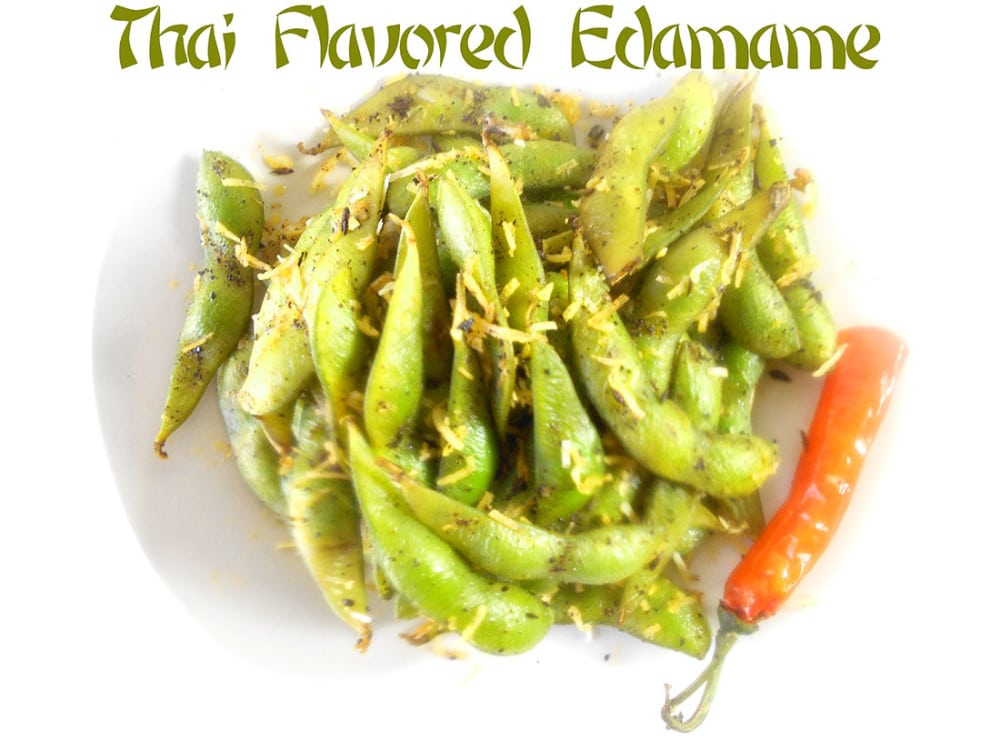 Overhead view of Thai Flavored edamame on a white plate