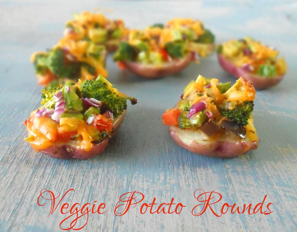 Front view of potato rounds loaded with vegetables and topped with cheese