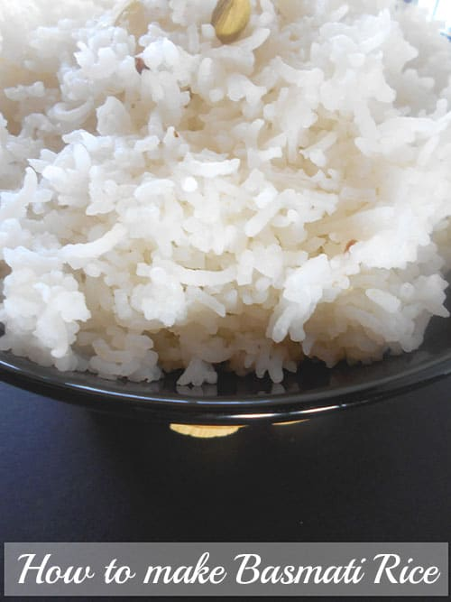 Closeup view of cooked basmati rice in a black bowl