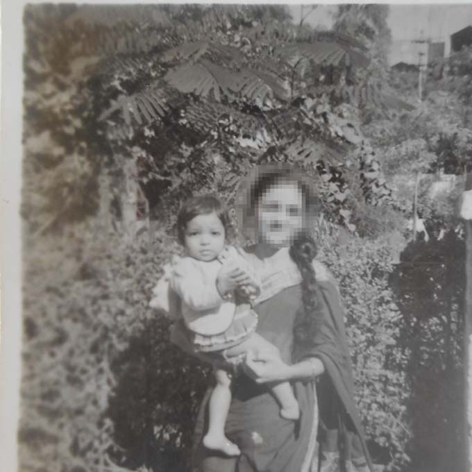 Black and white photo from the 1970s of the author and mother
