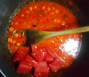 Cubed watermelon in pan with chickpeas and watermelon sauce