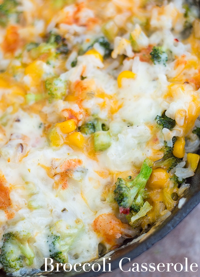 Closeup View of a Black Skillet Filled with Broccoli Rice Casserole and Topped with Melted Cheese
