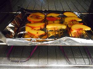 peaches roasting in a mini oven - Kale Salad