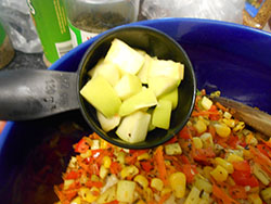 Cubed Apples added to a stir fry pan - Vegan Meatloaf recipe