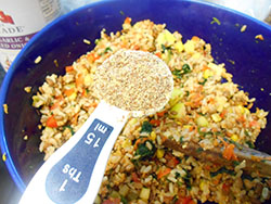 Flax seed meal added to a stir fry pan - Vegan Meatloaf recipe