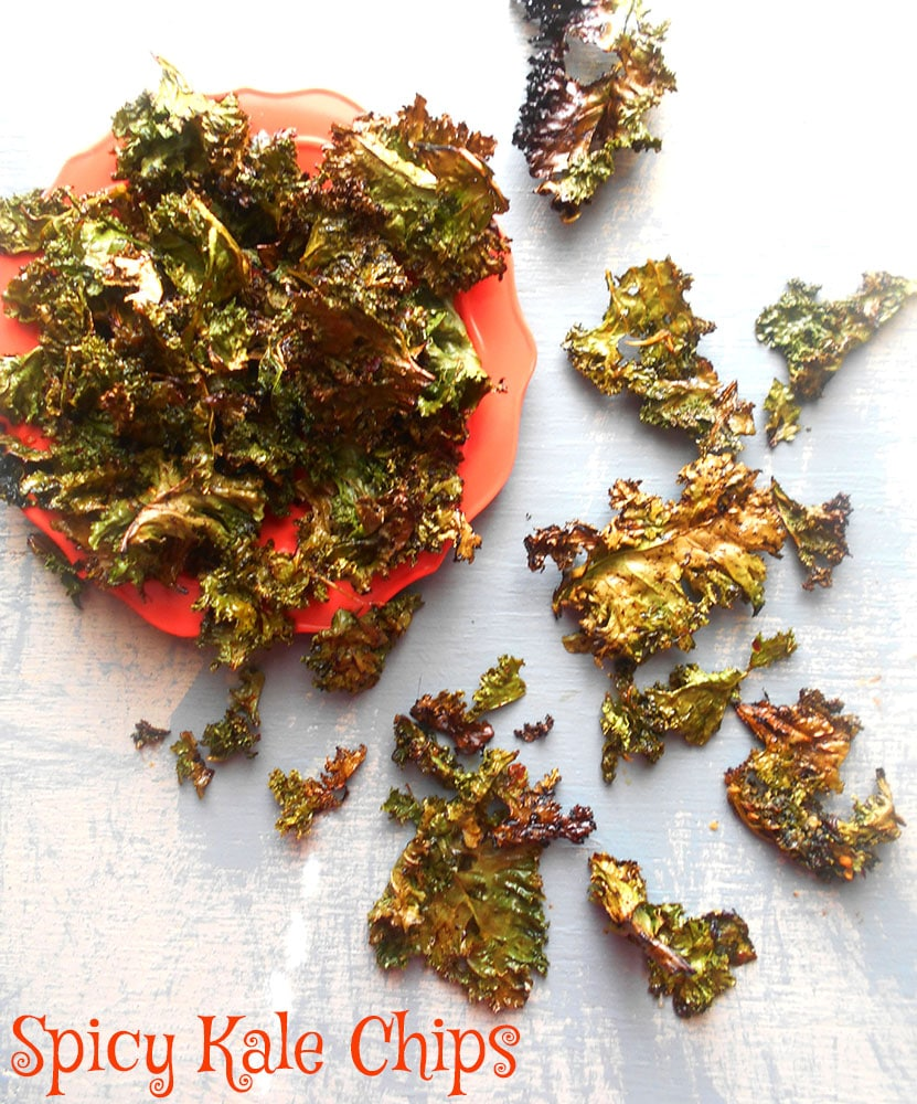 Spicy Kale Chips recipe made with Sriracha sauce. Quick snack idea that is also a healthy snack