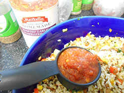 Mezzetta sauce added to a stir fry pan - Vegan Meatloaf recipe