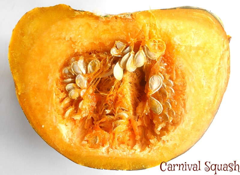 Overhead view of a carnival squash cut into half after being cooked