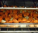 Front View of Baking Tray in the Oven With Cubed Sweet Potatoes and Turnips