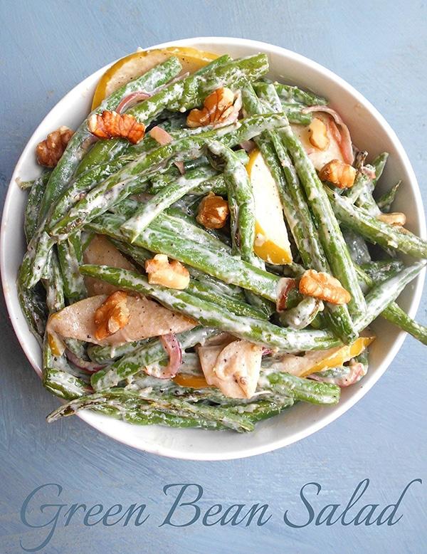Overhead view of green beans, wlanuts, apples in a creamy yogurt dressing - Green Bean Salad