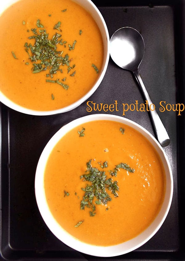 Overhead view of 2 soup bowls filled with sweet potato soup - 5 hearty vegan soups