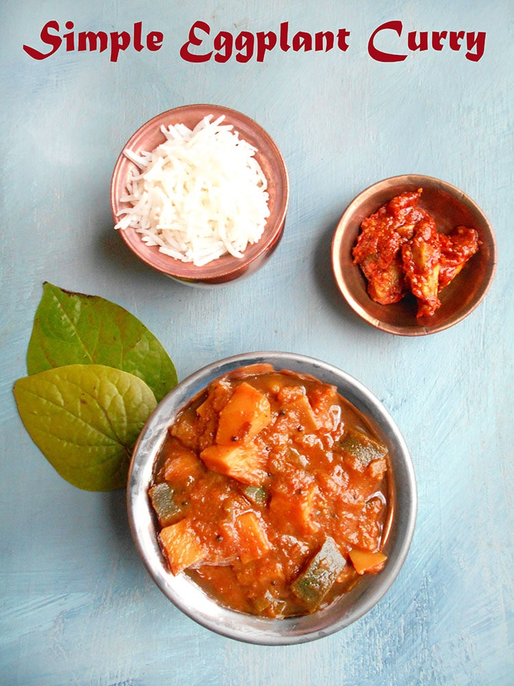 overhead view of eggplant curry with rice and pickles