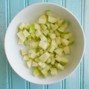 A bowl of chopped green apples in a white bowl - Cheerios