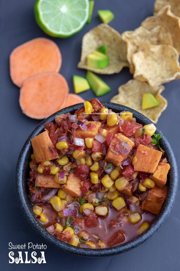 Overhead view of sweet potato salsa in a black bowl