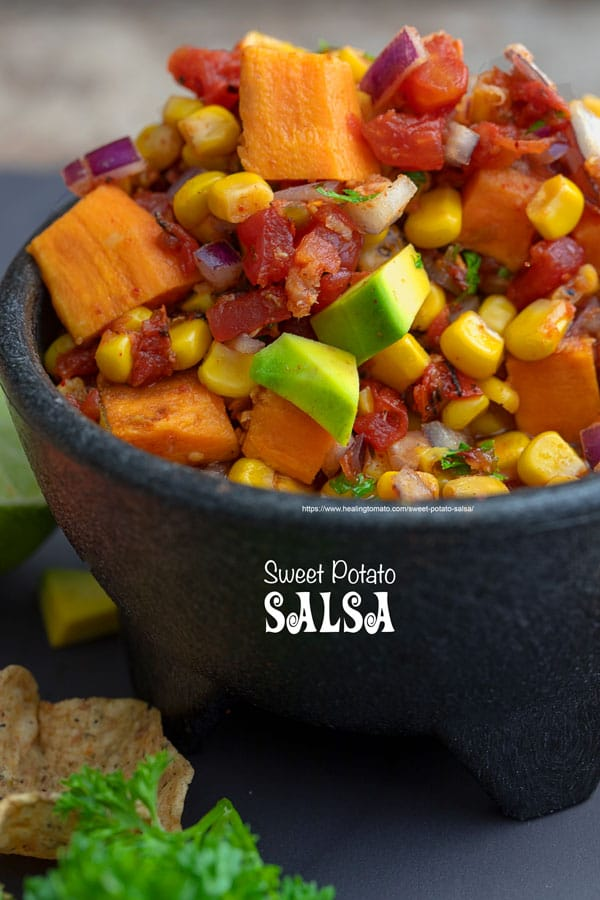 Closeup view of sweet potato salsa in a black bowl